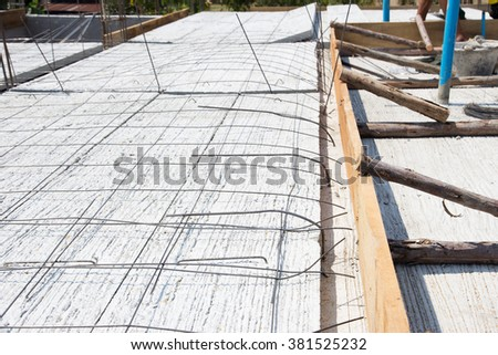 Wire Mesh on concrete slabs in construction site - stock photo