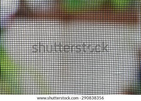 wire mesh on the door. - stock photo