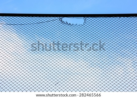 wire mesh steel with sky nature background - stock photo