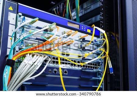 wire rack router mainframe in the data center - stock photo
