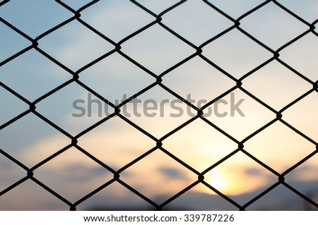 wire work in front of sunset