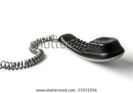 Wired telephone against white background