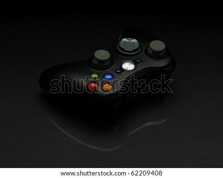 Wireless gamepad isolated on black background - stock photo