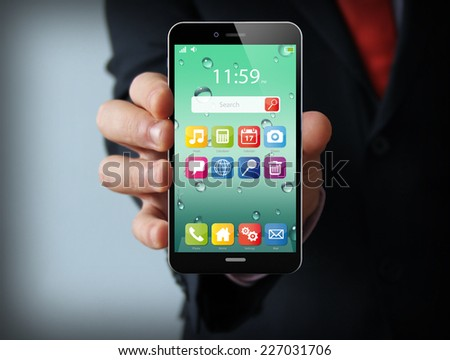 wireless, mobility and communications concept: businessman hand holding a phone with interface app on the screen  - stock photo