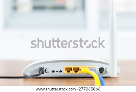 Wireless modem router network hub with cable connect on wooden table in the room - stock photo
