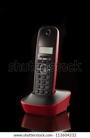 wireless phone station over black background - stock photo