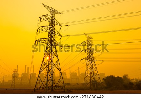 Wires and poles in the power plant with the sunrise in the morning. - stock photo