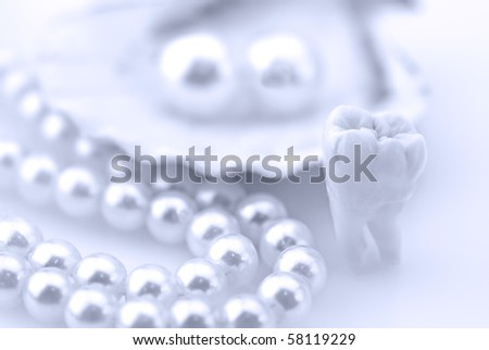 Wisdom tooth and natural pearls in an oyster shell. Healthy teeth concept - stock photo