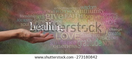 Wise Healing Words Parchment Website Header - wide softly colored stone effect banner with a female hand facing upwards surrounded by a word cloud relative to healing - stock photo