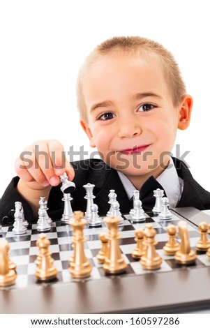 Wise little child player opening chess game - stock photo