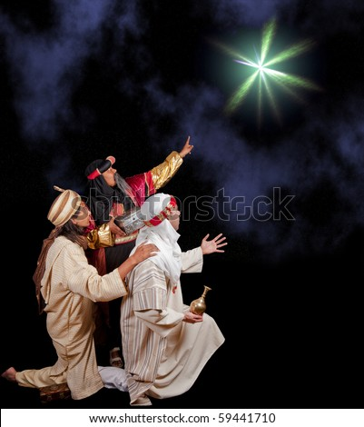 Wise-men Caspar Melchior and Balthasar following the star of Bethlehem - stock photo
