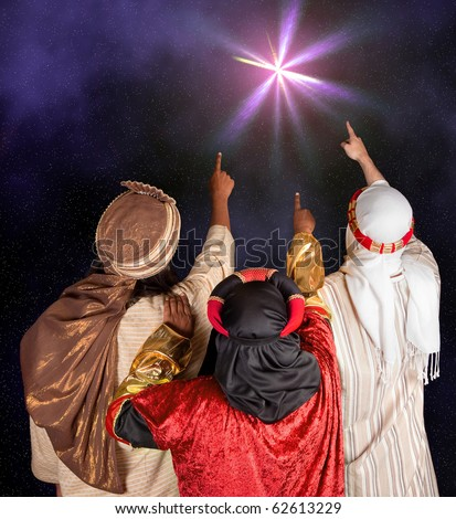 Wisemen Caspar Melchior and Balthasar following the star of Bethlehem - stock photo