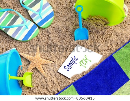 Wish You Were Here:  Beach towel surrounded by beach accessories, starfish & a blank post card w/color coordinated sample text suggest a summer beach vacation. Great BG, stock, concept, travel image.