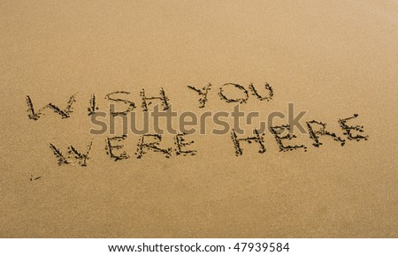 Wish You Were Here written in sand - stock photo