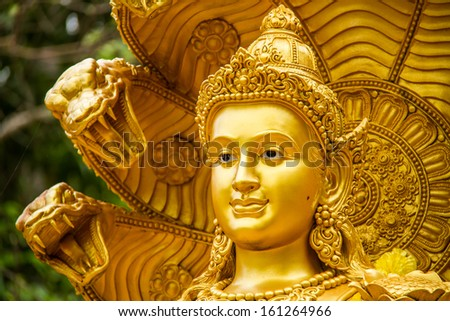 wisnu or narayana statue in huai tueng thao reservoir park, chiangmai , Thailand,statue in religion Thailand  ,  are public  domain  ,no restrict in copy or use . This photo  taken   these  conditions - stock photo