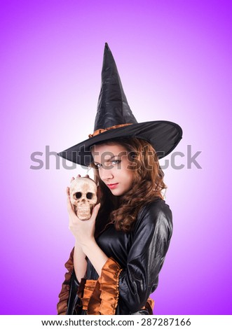 Witch against the colourful gradient - stock photo