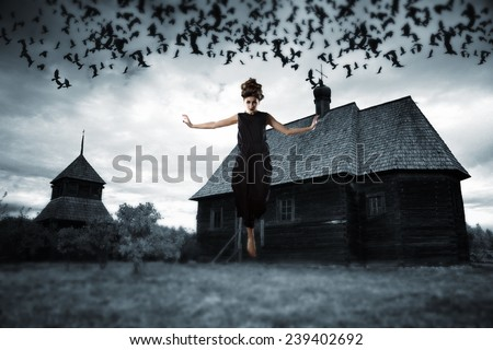 Witch floating in the air. picture in the style of a horror movie. - stock photo