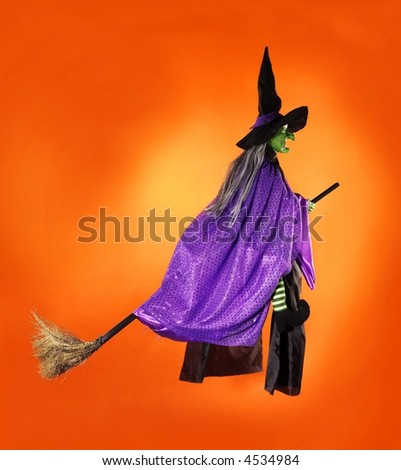 Witch flying on a brrom - stock photo