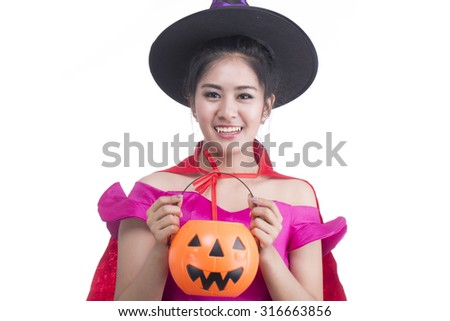 witch holding pumpkin with white background.
