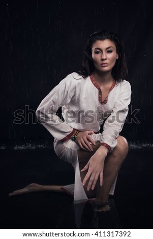 Witch in the water. Fantasy girl. Mysterious Night scene.  - stock photo