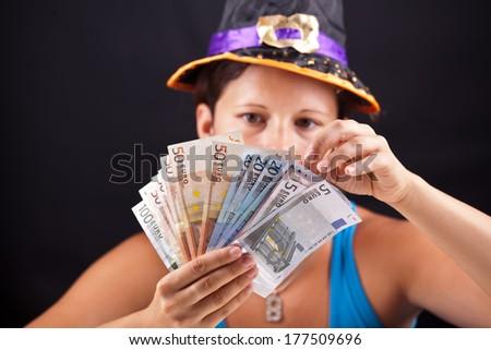 witch show money in studio - stock photo
