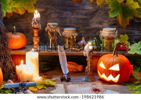 Witch table with halloween pumpkin - stock photo