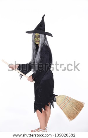 Witch with Broom - stock photo