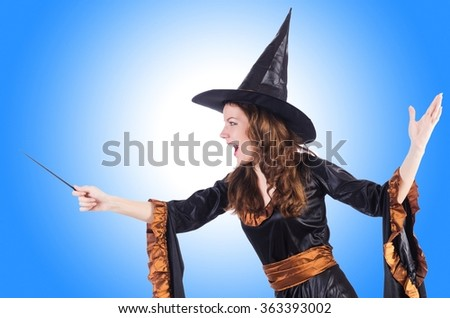 Witch with wand isolated on the white - stock photo