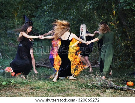 witches dancing around the campfire - stock photo
