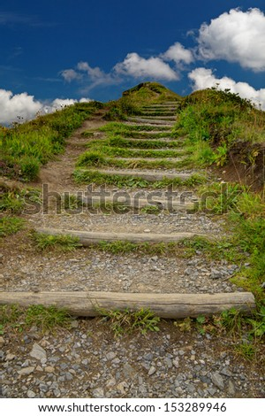 With an effort to target on the mountain - stock photo