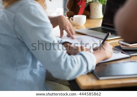 with reflection  closeup female hands over business document with graph and chart to  cofee  cafe   - stock photo