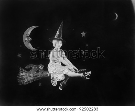 With the man in the moon and a witch on a broom, a flight of fantasy lights the night sky - stock photo
