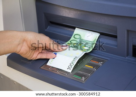 Withdrawal euro banknote on the cachsmachine - stock photo