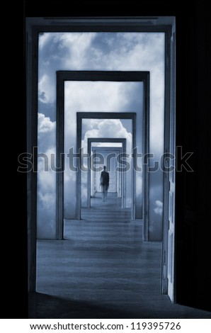 Within a Dream 1, silhouette in a corridor in front of a closed door. Rite of passage concept. Linear perspective view through several open doors and empty rooms. - stock photo