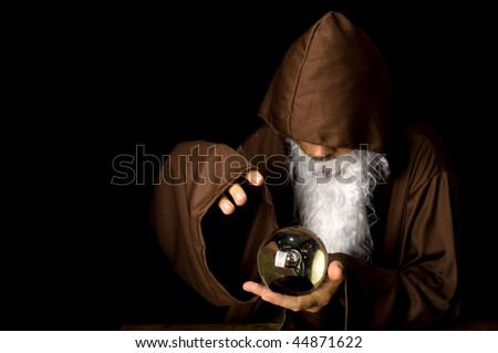 Wizard and his Crystal Ball - Waiting for your Future . - stock photo