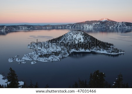 Wizard Island Winter at Crater Lake Oregon, sunset - stock photo