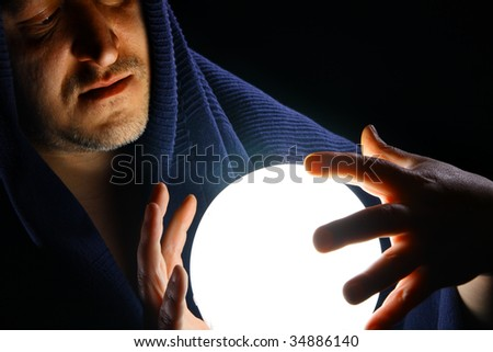 Wizard with glowing magical ball - stock photo