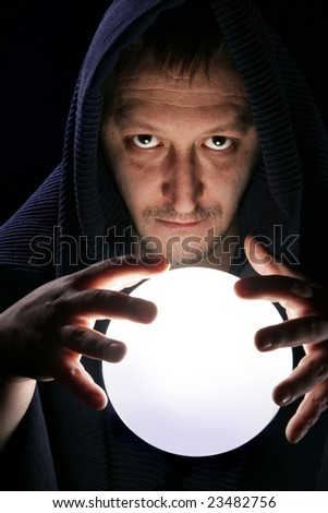 Wizard with glowing magical ball close-up - stock photo