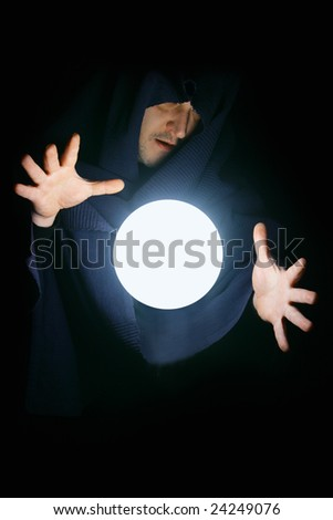 Wizard with glowing magical sphere close-up - stock photo