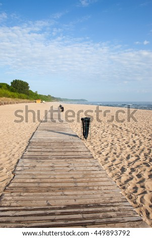 Wladyslawowo in Poland, beach with wooden boardwalk at Baltic Sea - stock photo