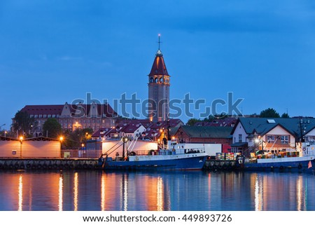 Wladyslawowo town skyline in Pomerania, Poland at night, view from the port