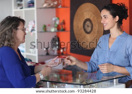 woan paying with credit card - stock photo
