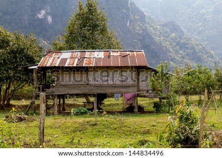 Wodden hut with metal roof in Laos. Represents the poor lifestyle in the country.