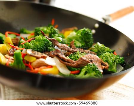 wok with stirfry - stock photo