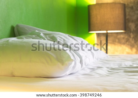 woke up in the morning and unmade bed. blurred background. - stock photo