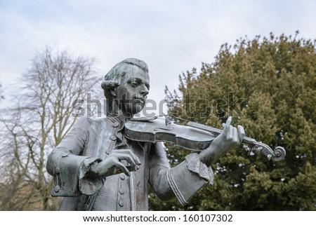Wolfgang Amadeus Mozart statue in Parade Gardens, Bath Spa, Somerset. - stock photo