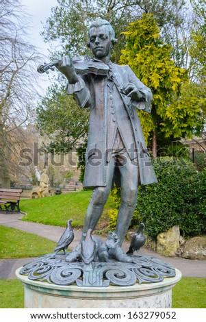 Wolfgang Amadeus Mozart statue in Parade Gardens, Bath Spa, Somerset, UK - stock photo