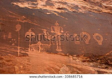 wolfman petroglyph panel in comb ridge, near bluff,  utah - stock photo