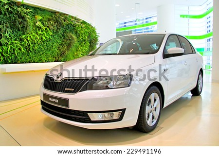 WOLFSBURG, GERMANY - AUGUST 14, 2014: Czech car Skoda Rapid at the museum of the Volkswagen Autostadt. - stock photo