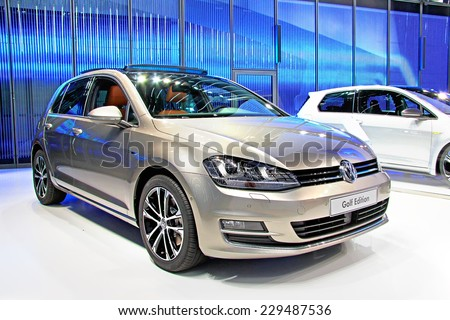 WOLFSBURG, GERMANY - AUGUST 14, 2014: German car Volkswagen Golf at the museum of the Volkswagen Autostadt. - stock photo
